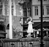 Child dancing on the town square - Brugge (Belgium)