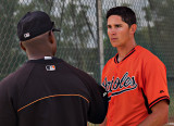 Steven talking with his pitching coach, Alan Mills, after pitching the top of the 1st.