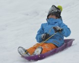 Colten sliding with his sister