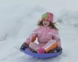 Jordan sliding with her brother