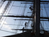 Men going up to put the sails up