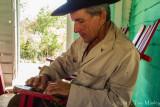 Palenio Rolling a Cigar, III
