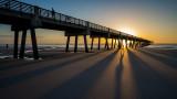 Runner and Pier at Sunrise