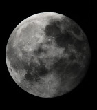 Super moon partially under cloud cover.