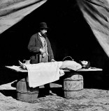 Embalming a dead soldier