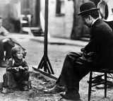 1921 - Jackie Coogan with Chaplin on the set of The Kid