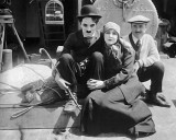 1917 - Chaplin with Edna Purviance and his half-brother Sydney