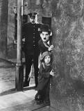 1921 - Charlie Chaplin and Jackie Coogan in The Kid