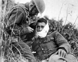 September 1918 - Receiving first-aid treatment from a comrade