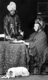 1885 - Queen Victoria assisted by Abdul Karim