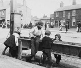 c. 1900 - Playing at a water trough, Barnet High Street