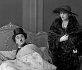 1921 - Charlie Chaplin and Edna Purviance in The Idle Class