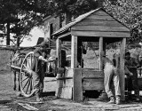 1864 - Union soldiers drawing water from a well to fill their water cart