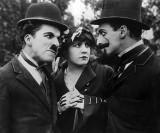 1915 - Charlie Chaplin, Edna Purviance, and Leo White
