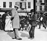 1897 - Policeman and street musician