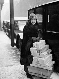 1920 - Anna Held with Christmas packages