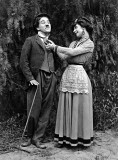 1914 - Charlie Chaplin and Minta Durfee in The Star Boarder