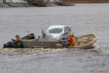 Vehicle headed to Moose Factory from Moosonee on small barge.