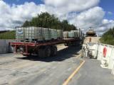 Innes Transport truck and trailer back onto barge Niska I in Moosonee.