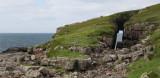 Sea cave arch on Handa Island looking south