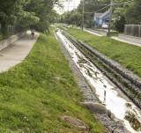 Jogger Along Drainage Ditch