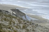 8584 - The waves swallowed up several metres of sand dunes
