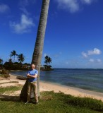 Posing by a palm tree
