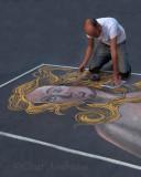 Chalk artist on the street in Rome