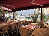 Empty cafe tables- Port Grimaud