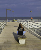 A mysterious lone figure at the end of the Harbor Beach pier.