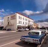 The Holland Hotel, Alpine, TX, with a vintage Chevy in the foreground