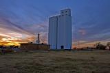 Dacoma, OK grain elevator at sunset.