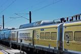 DIA Train cars painted with the University of Colorado-Denver, Colorado.