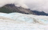 Hikers in the distance on Root Glacier in Wrangell-St Elias National Park