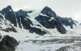 Thick glacier surrounds a rocky peak near Shamrock Glacier