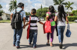 THE WAY MIAMI HELPING FAMILIES AND THE CHILDREN WITH SUPPLIES AND BACKPACKS FOR BACK TO SCHOOL
