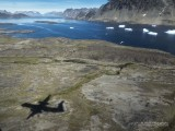 Approaching Greenland in a propeller airplane