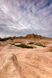 Clouds and light play over the badlands