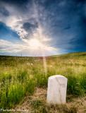 Sunstar near a calvary man's grave