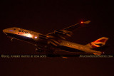 2013 - British Airways One World B747-436 G-BNLI night takeoff aviation airline stock photo