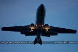 2013 - Lear Jet on short final approach to Opa-locka after sunset corporate aviation stock photo
