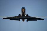 2013 - Gulfstream corporate jet on short final approach after sunset aviation stock photo