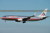 2014 - American Airlines B737-823(WL) N976AN with company aircraft behind the main gear aircraft aviation stock photo #3300