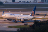 2015 - United Airlines B737-924ER N66828 rare takeoff on runway 28 at TPA aviation airline stock photo #9376