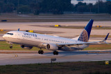 2015 - United Airlines B737-924ER N66828 rare takeoff on runway 28 at TPA aviation airline stock photo #9377