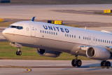 2015 - United Airlines B737-924ER N66828 rare takeoff on runway 28 at TPA aviation airline stock photo #9377C