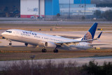 2015 - United Airlines B737-924ER N66828 rare takeoff on runway 28 at TPA aviation airline stock photo #9378