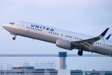 2015 - United Airlines B737-924ER N66828 rare takeoff on runway 28 at TPA aviation airline stock photo #9380