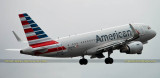 American Airlines Airbus A319-112 N5007E on takeoff roll on runway 27 aviation airline stock photo