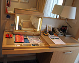 Desk, with top up. Bottom right drawer is minibar/fridge